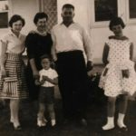 Zampin family, outside family home, c 1962
